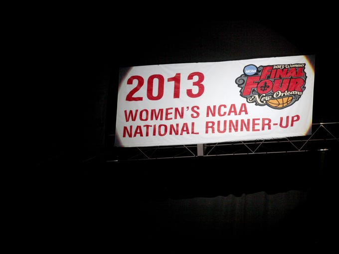 The 2013 women's NCAA National Runner Up banner is revealed at the KFC Yum! Center. November 24, 2013
