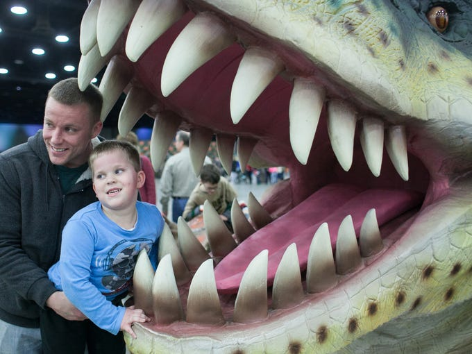 Clay Hammond, left, and his son Cooper Hammond, age 5, pose inside a dinosaurs mouth for a family snapshot. Feb., 2, 2013
