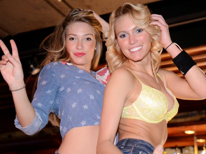 Allison and Madison Cook at Sully's, which was hosting Playboy Playmate Crissy Henderson and drew a large crowd of regulars and attendees in town for the Farm Machinery Trade Show on Thursday night. February 13. 2014.