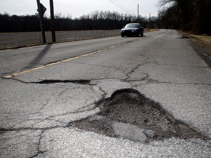 A pot hole is seen on River Road. February 19, 2014