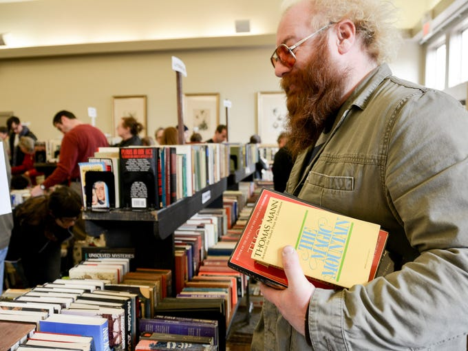 Low Hale picking up some essentials at the at the Locust Grove Spring Used Book Sale.
