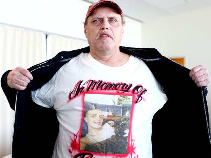 Steve Lewis wears a shirt in remembering his son Bryan Lewis at the Muhammad Ali Center, during Hope and Healing a community celebration of life remembering those who have suffered a violent death by homicide, suicide or accident. March 9, 2014