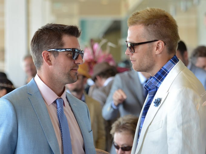NFL stars Aaron Rodgers and Tom Brady enjoy the 2014 Kentucky Derby at Churchill Downs. May 3, 2014.