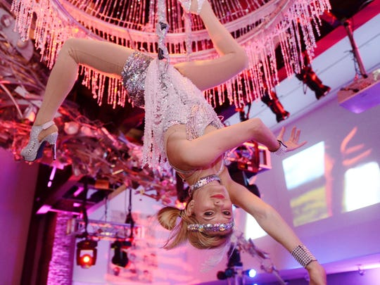 An aerialist performed at the 21C Hotel and Museum Derby Party on May 3, 2014.