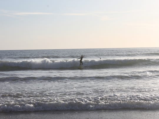 A young surfer rides at San Elijio State Beach, just south of Encinitas in Cardiff, Calif.