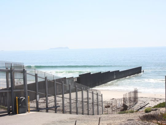 The border fence separating the United States and Tijuana, Mexico, sstretches into the Pacific Ocean in Border Field State Park south of San Diego.