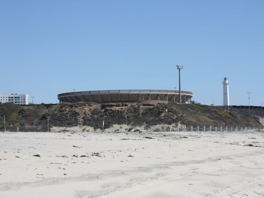 The beach trail from the entrance to Border Field State Park takes visitors thisclose to Tijuana, Mexico, and its seaside bullfighting ring.