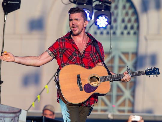 Juanes performs on stage during the Made In America Festival at Grand Park on Sunday, Aug. 31, 2014, in Los Angeles.