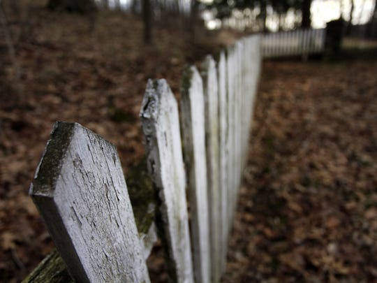 Broken fencing around the Industry Residential Center graveyard in Rush.