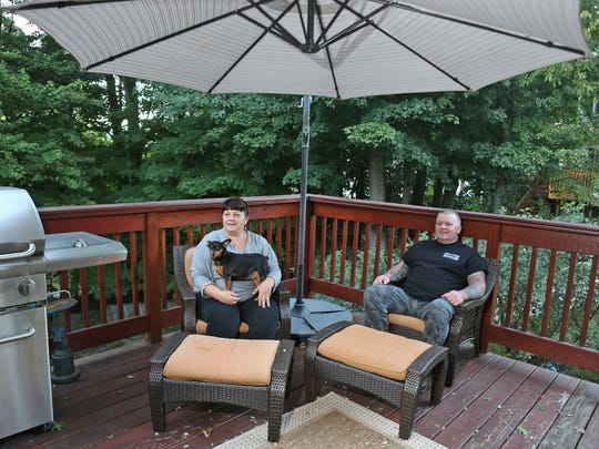 Debbie and Daniel Calabro sit on the back porch of their home in the Colonial Ridge development in Peekskill Sept. 23, 2014.  Colonial Ridge is a cul-de-sac consisting of seven two-family homes built in late 1997 that were sold as affordable homes to first-time buyers. The Calabros are one of the original homeowners in the development.