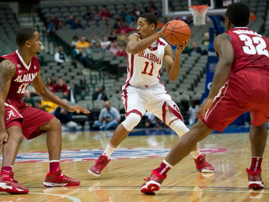 Isaiah Cousins, No. 11 of the Oklahoma Sooners, brings the ball upcourt against the Alabama Crimson Tide during the Tip-Off Showcase on Nov. 8 at the American Airlines Center in Dallas.