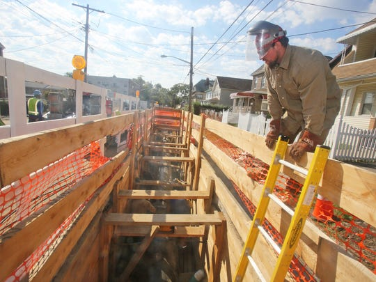 A welder looks down at a section of a new 36-inch gas transmission line being installed on S. 9th Ave. in Mount Vernon Sept. 19, 2014. Con Edison is replacing an old 24-inch transmission line the runs from the Bronx to White Plains.