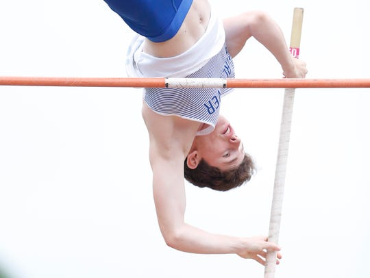 Pearl River's Conor Burke competes in the pole vault