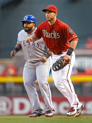 Arizona Diamondbacks first baseman Paul Goldschmidt (44) works at first against Texas Rangers first baseman Prince Fielder (84) in the first inning of their MLB game on April 22, 2015  in Phoenix.