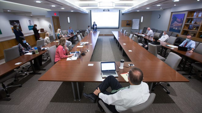 Staff members at Stormont Vail Health congregate Thursday morning for their daily command center meeting.