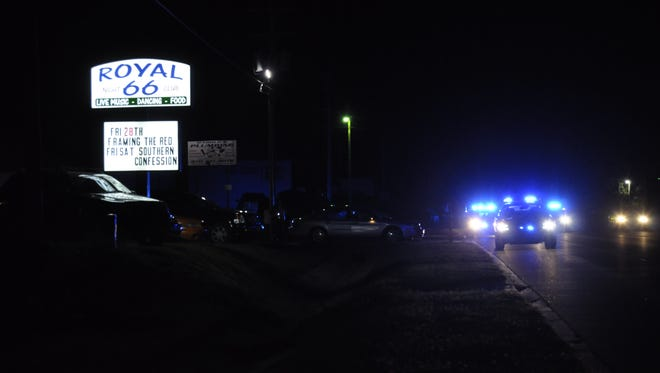 Police work the scene of an accident on U.S. Highway 62 East late Friday night. A pedestrian was reportedly seriously injured when he was struck by a car.