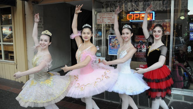 Sarah Franklin, Jasmine Mong, Grace Hall and Gabi Frassenei of Premiere Academy of Performing Arts at the Statesman Journal's Holding Court at the Court Street Dairy Lunch in downtown Salem on Monday, Dec. 11, 2017.