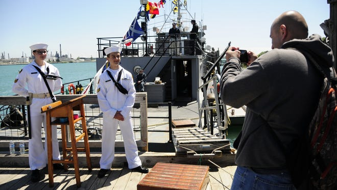 Jeremy Stapleton takes a photo of U.S. Naval Sea Cadets Hannah Smith and Michael Castillo during the Be a Tourist in Your Own Town event on Saturday, June 2, 2018 in Port Huron.
