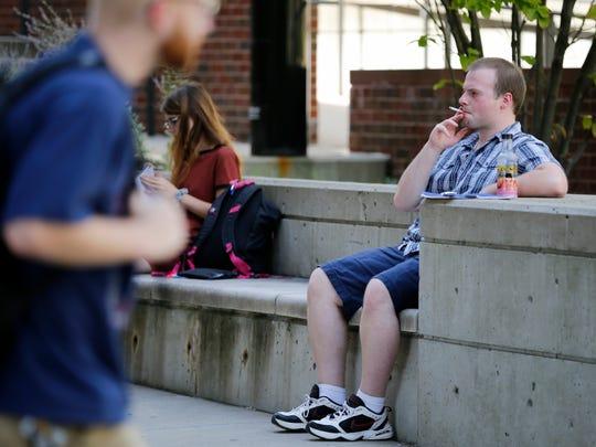 UC student Austin Larrick, 22, of Mason, stops for a smoke outside of Swift Hall.