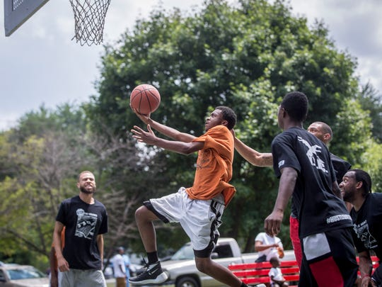 FILE -- People gather at the basketball courts at McCulloch Park during a previous edition of the Stop the Violence Summer Basketball Classic. The event, organized by Muncie locals, offers a break from the tension around the area and nation.