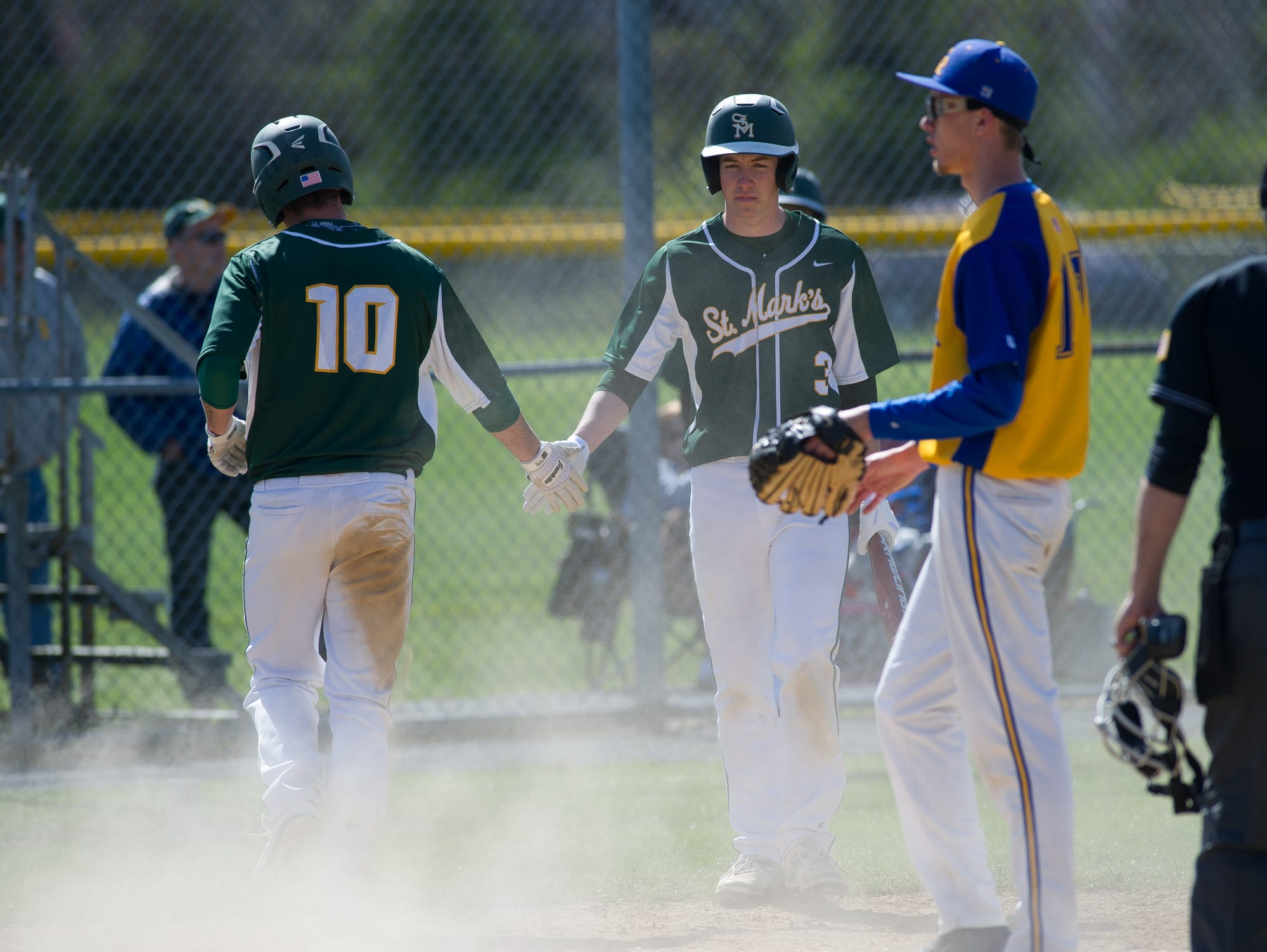 5th 16-1 St. Mark's Eric Cella (10) walks away from home plate after scoring in the 5th inning to make the score 16-1 in their game against Caesar Rodney.