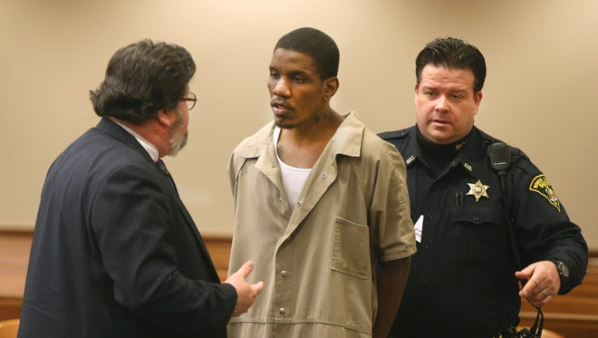 Thomas Johnson III with his attorney James Hinman in court.