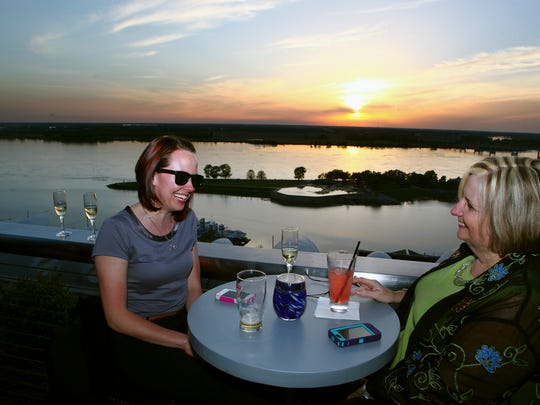April 25, 2013 - (left to right) Kristen Vanek and Tammy McLemore enjoy a sunset view of the Mississippi River during the grand opening of the Twilight Sky Terrace on the rooftop of the Madison Hotel. (Kyle Kurlick/Special to The Commercial Appeal)