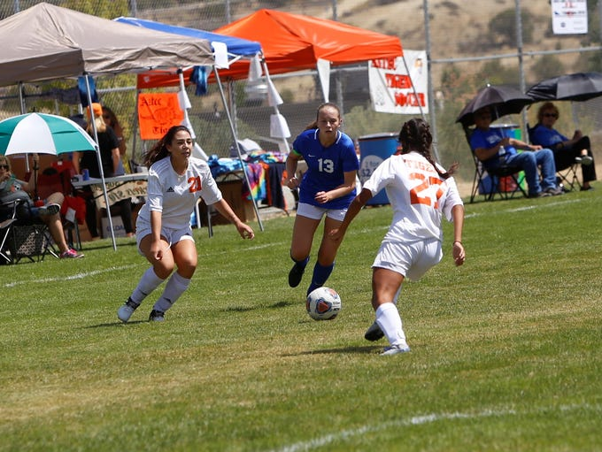 Carlsbad's Emma Haston goes after the ball against