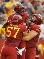 Iowa State outside lineman Colin Newell (57) and linebacker