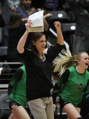 Tiago Head Volleyball Coach Mindy Patton, Windthorst and Midwestern State graduate, celebrates her team's 1A state championship win Thursday, Nov. 17, 2016, at the Curtis Culwell Center in Garland. The Lady Bulldogs won in five sets against Bronte.