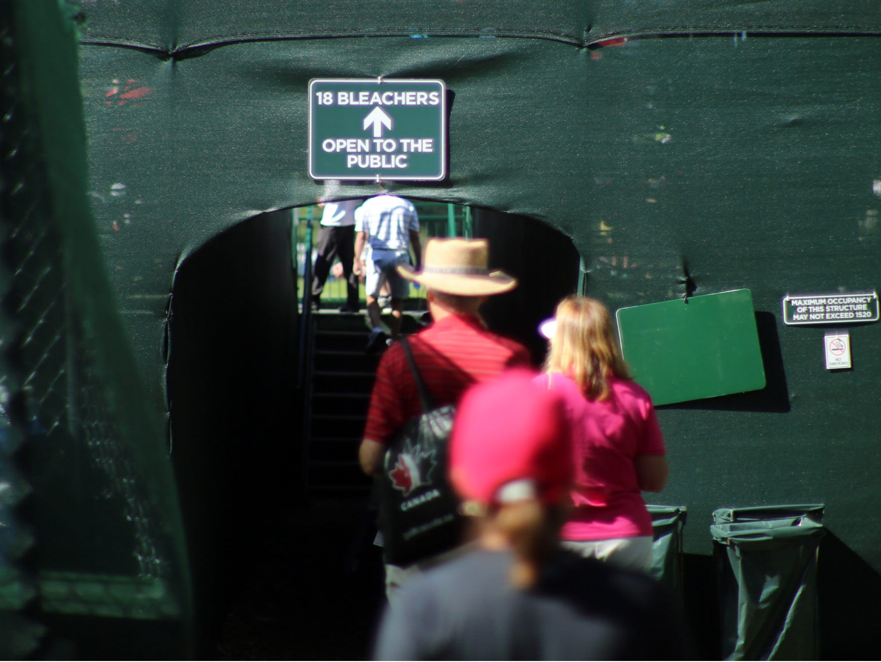Fans enter the grandstands on the 18th green.