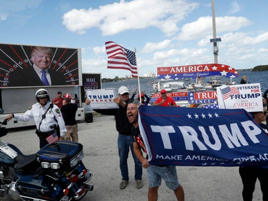 Supporters of President Donald Trump gather outside Mar-a-Lago, Saturday, March 4, 2017, in Palm Beach, Fla.