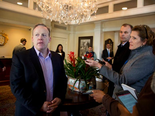 White House press secretary Sean Spicer, speaks to reporters as President Donald Trump meets with some members of his cabinet and the White House staff, Saturday, March 11, 2017, at the Trump National Golf Club in Sterling, Va.