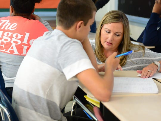 Lee Argo, teacher at  Millsboro Middle School helps one of her students during math class on Friday, Sept. 16, 2016.