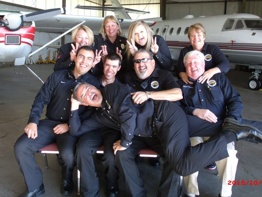 Staff at Sierra Blanca Regional Airport ham it up for a photograph that illustrates the team mentality. Pearce is at bottom right and Assistant Airport Manager Sean Parker relaxes in front. But when an emergency occurs, the staff is well-trained and all business.