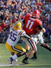 Georgia quarterback Jake Fromm (11) is sacked by LSU linebacker Michael Divinity Jr. (45) during the third quarter of an NCAA college football game Saturday, Oct. 13, 2018, in Baton Rouge, La. (Bob Andres/Atlanta Journal Constitution via AP)