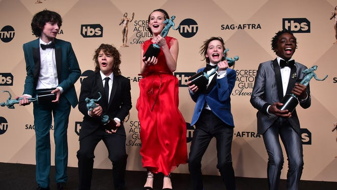Finn Wolfhard, Gaten Matarazzo, Millie Bobby Brown, Noah Schnapp, and Caleb McLaughlin jumped for joy after receiving the Outstanding Performance by an Ensemble in a Drama Series award for 'Stranger Things.'