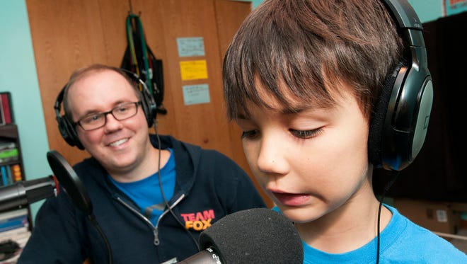 Jonathan Messinger and his seven-year-old son, Griffin, brainstorm ideas for the Halloween episode of their sci-fi podcast.
