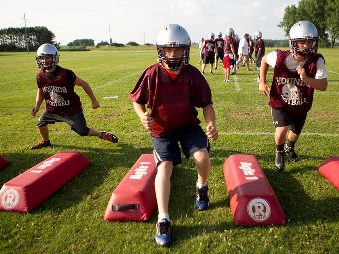 Loyal football players run through footwork drills during football practice at Loyal High School, Wednesday, Aug. 6, 2014.