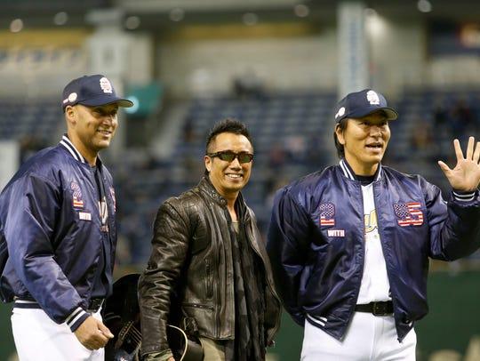 Former Yankees Derek Jeter, left, and Hideki Matsui,