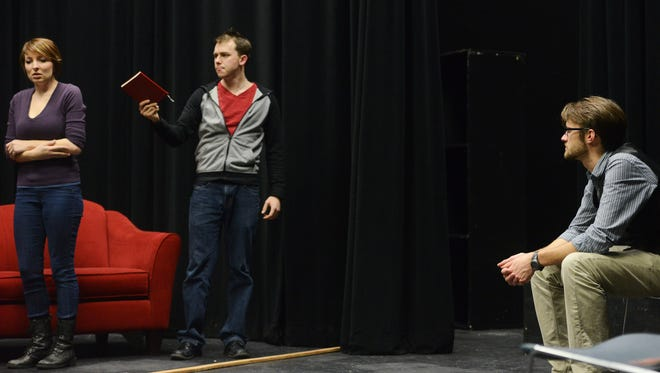 """Director, Jonathan Fondell watches as Debbi Jones, plays Mary, and Matt Stoffel, plays Crick, as they rehearse the play: """"Late, A Cowboy Song"""" Wednesday night at the Edith Mortenson Center at Augustana University Jan 13, 2016. The play is the first produced by the Monstrous Little Theatre Company which was founded by Fondell, Jones and Stoffel."""