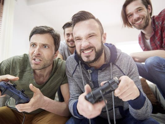 video-games-4-guys-smiling-playing-getty_large.jpg