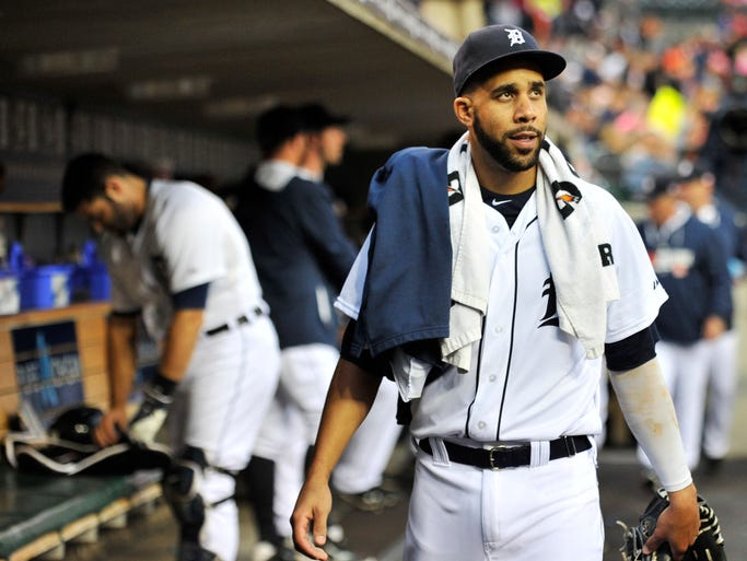 Tigers pitcher David Price walks through the dugout near the start of the game.  Detroit Tigers win 7-2 over the Cleveland Indians at Comerica Park in Detroit on Sept. 12, 2014.
