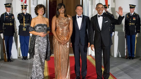 Barack and Michelle Obama greet Italian Prime Minister