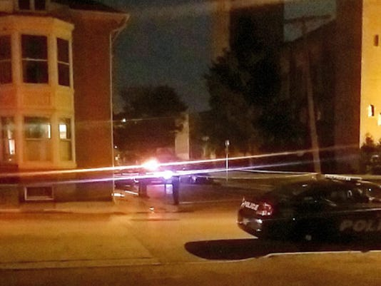 York City Police investigate after a shooting late Monday night near Penn Park. (Sean Philip Cotter - scotter@yorkdispatch.com)