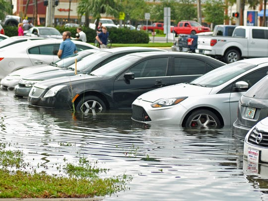 FILE - Vehicles water damaged at the1300 block of south