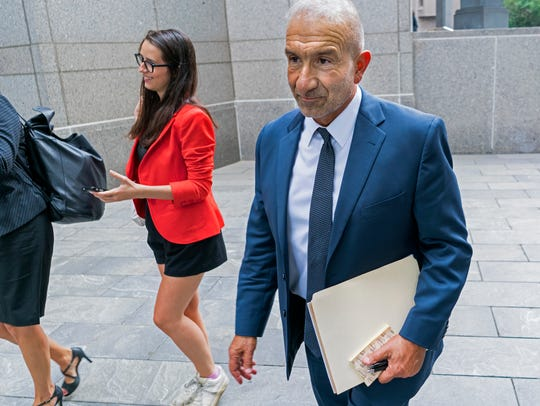 Alain Kaloyeros, right, former president of the State University of New York's Polytechnic Institute, walks from the Federal courthouse in New York, Monday, June 18, 2108.