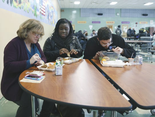Reporters Tracy Schuhmacher and Justin Murphy eat lunch