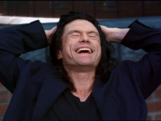 "Tommy Wiseau as Johnny in ""The Room."""