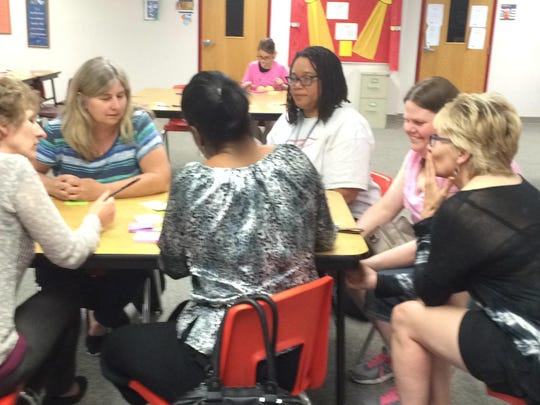 """Farmington Public Schools parents discuss questions posed at the """"Listening and Learning Session"""" June 3."""